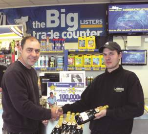 John Haynes, Aspect Windows, being handed champagne by Wayne Tracey TheBIGTradeCounter Manager
