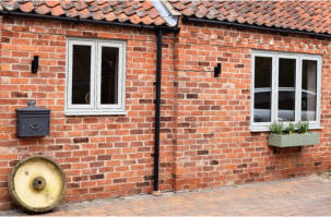ADM Windows uses Spectus Flush Casement windows to enhance heritage looks of a barn conversion in Worksop