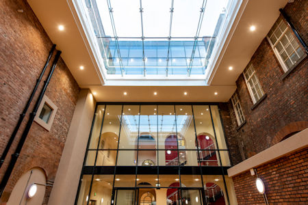 - Structural glazing raises the roof at famed performing arts school