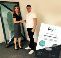 REAL Aluminium has named Premier Roof Systems as the lucky winner of its 'Take the Leap' prize draw.