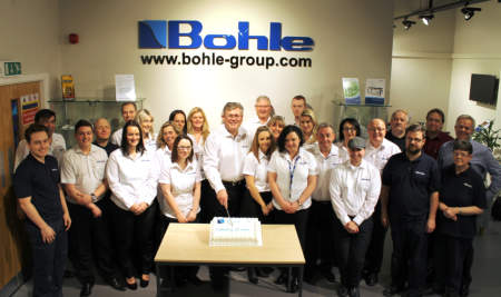 <br />Bohle with cake, the team 20 years on