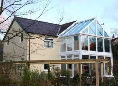 <br />A bespoke design that spans two floors, the gable-style conservatory uses this self-cleaning glazing to offer spectacular views of the Welsh countryside.