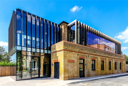 Modern glazing brings new life to Victorian gatehouse as student hub